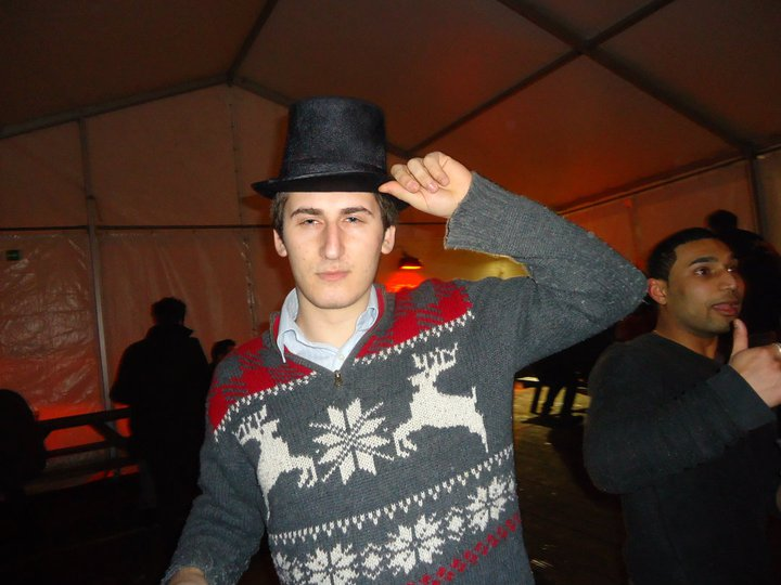 Alex in Christmas Jumper and Top Hat - Legendary.
